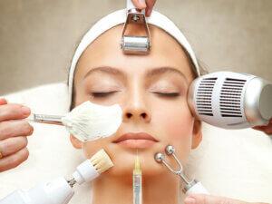 Woman having multiple skin treatments