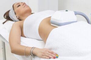 Woman having a fat freezing treatment