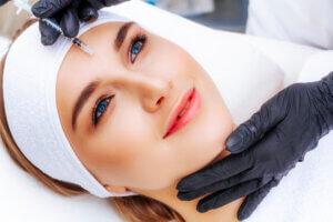 Woman getting a vampire facial